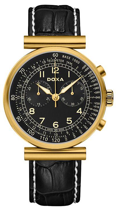 Elegancki, męski zegarek Doxa Telemeter na skórzanym pasku z białymi szwami po bokach. Koperta zegarka jest ze stali w złotym kolorze. Analogowa tarcza zegarka jest ozdobiona indeksami w kolorze żółtego złota.