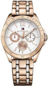 Elegancki, damski zegarek Tommy Hilfiger 1781666 na stalowej bransolecie pokrytej PVD w kolorze różowego złota. Koperta zegarka jest okrągła w kolorze różowego złota ze stali. Analogowa tarcza zegarka jest w białym kolorze z trzema subtarczami w kolorze różowego złota. Wskazówki jak i indeksy są w białe z obwódką w kolorze różowego złota.