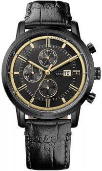 Elegancki, męski zegarek Tommy Hilfiger 1791245 na skórzanym pasku ze stalową kopertą w czarnym kolorze. Analogowa tarcza zegarka w czarnym kolorze posiada datownik na godzinie trzeciej oraz trzy subtarcze, które ozdobione są złotym kolorem.