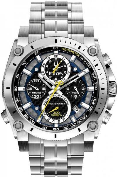 Sportowy, męski zegarek Bulova 96G175 Precisionist na klasycznej, srebrnej bransolecie wykonanej ze stali. Koperta, tak samo jak bransoleta została wykonana ze stali również w srebrnym kolorze. Analogowa tarcza zegarka Bulova jest w czarno-srebrnym kolorze z czterema subtarczami z żółtymi wskazówkami. Wskazówki zegarka są w srebrnym kolorze z sekundnikiem, który jest żółty.