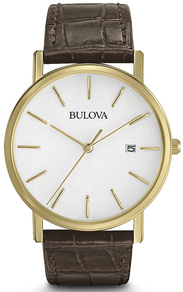 Elegancki, męski zegarek Bulova 97B100 Classic na brązowym skórzanym pasku z kopertą w złotym kolorze wykonaną ze stali. Analogowa tarcza zegarka jest w białym kolorze z datownikiem na godzinie trzeciej, wskazówki oraz indeksy są w złotym kolorze w postaci kresek.