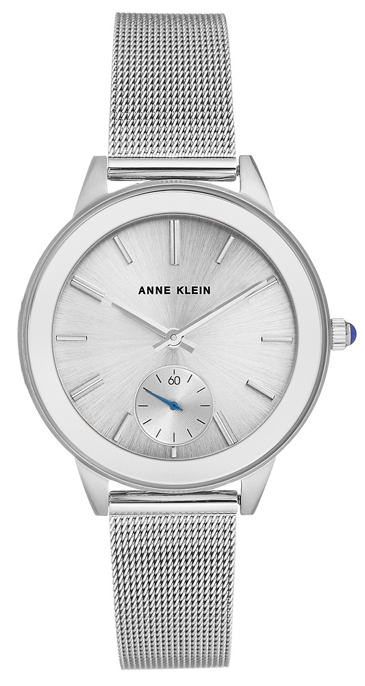 Elegancki, damski zegarek Anne Klein na srebrnej bransolecie typu mesh wykonanej ze stali oraz koperty wykonanej z tego samego materiału jak i w tym samym kolorze. Analogowa tarcza zegarka jest w srebrnym kolorze z subtarczą, z niebieską wsazówką pokazująca sekundy.