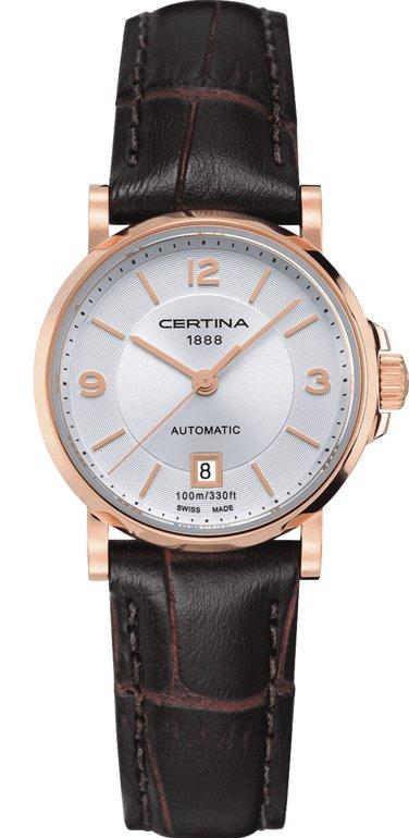 Klasyczny, damski zegarek Certina C017.207.36.037.00 DS Caimano Lady Automatic na skórzanym pasku w brązowym kolorze oraz okrągłą kopertą za stali w kolorze różowego złota. Analogowa tarcza jest w srebrnym kolorze z datownikiem i indeksami oraz wskazówkami w kolorze różowego złota.