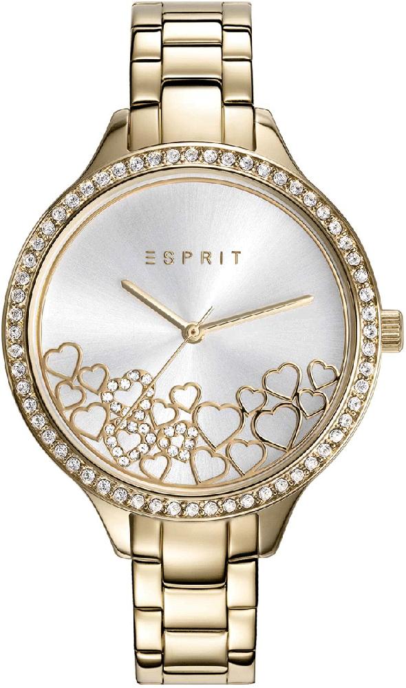 Biżuteryjny, damski zegarek Esprit ES109592002 na bransolecie ze stali w złotym kolorze oraz z koperta z tego samego materiału w tym samym kolorze. Tarcza zegarka jest biała z małymi serduszkami na dolnej części tarczy.