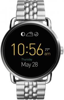 Modny, damski zegarek Fossil FTW2111 Q Wander Smartwatch na stalowej bransolecie w srebrnym kolorze z okrągłą kopertą wykonana ze stali również w srebrnym kolorze. Tarcza zegarka Fossil jest cyfrowa.