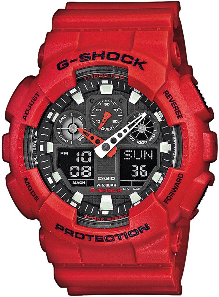 Sportowy, męski zegarek G-Shock GA-100B-4AER Original na pasku z tworzywa sztucznego w czerwonym kolorze. Koperta zegarka jest również wykonana z tego tworzywa oraz w tym samym kolorze. Tarcza zegarka jest szara z wskazówkami w kolorach takich jak biały oraz czerwony.