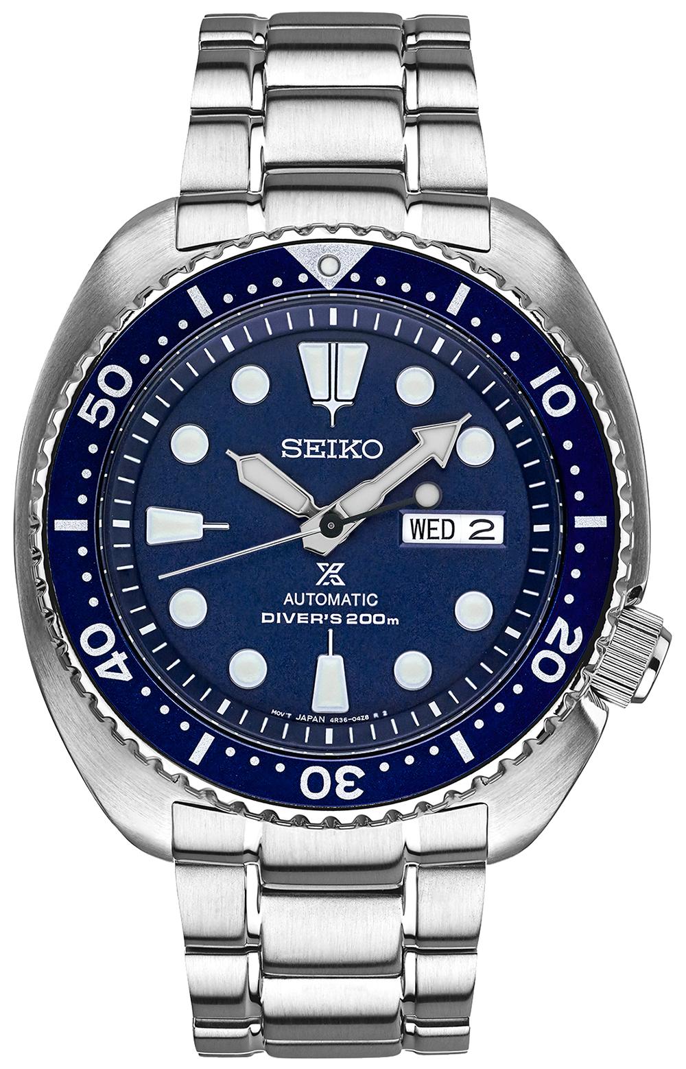 Klasyczny, męski zegarek Seiko SRP773K1 Automatic na srebrnej, stalowej bransolecie oraz kopercie z tego samego materiału i w tym samym kolorze. Bezel zegarka jest w niebieskim kolorze z białym numerowaniem. Tracza zegarka jest niebieska z indeksami i wskazówkami pokrytymi Neobrite.