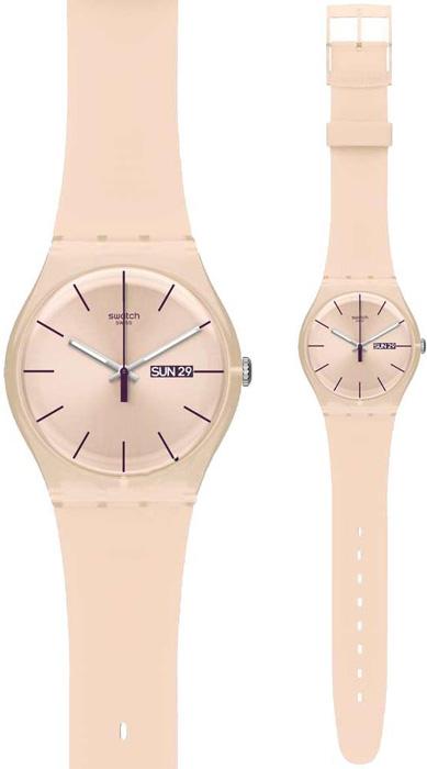 Stylowy, damski zegarek Swatch SUOT700 ROSE REBEL na beżowym pasku z tworzywa sztucznego. Koperta zegarka Swatch jest z tworzywa sztucznego w kolorze beżu. Analogowa tarcza zegarka jest w beżowym kolorze z fioletowymi wskazówkami jak i indeksami.