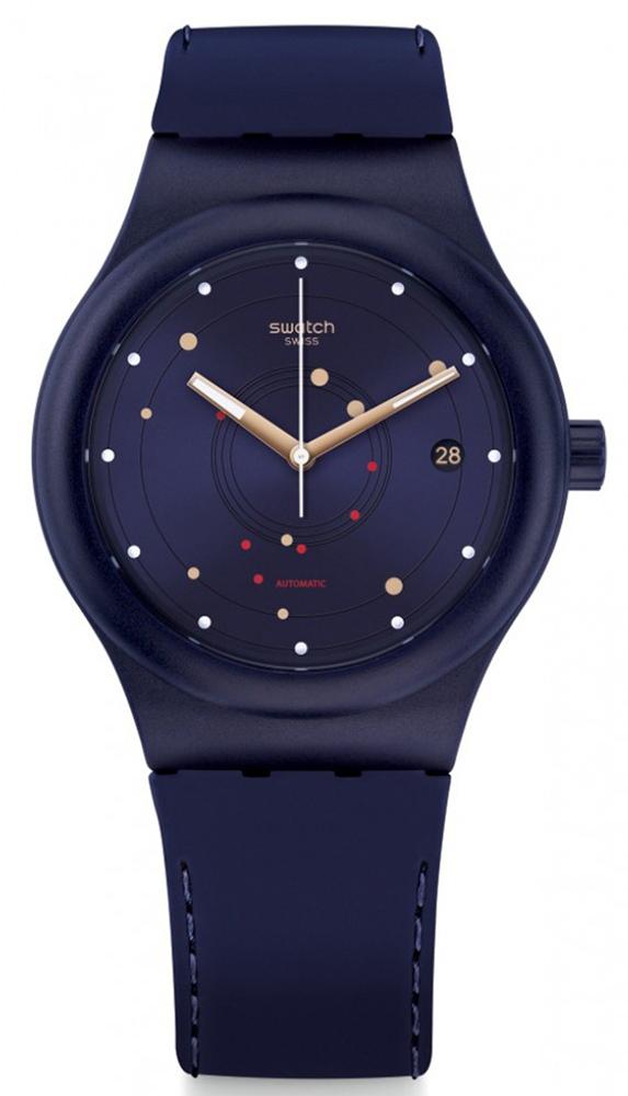 Młodzieżowy, damski zegarek Swatch SUTN403 Sistem Sea na silikonowym pasku w kolorze fioletowym. Koperta zegarka jest z tworzywa sztucznego. Analogowa tarcza jest w tym samym kolorze co pasek, ozdobiona małymi kropkami w kolorze czerwieni, złota oraz bieli.