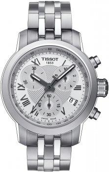 Elegancki, damski zegarek Tissot T055.217.11.033.00 PRC 200 CHRONOGRAPH LADY na bransolecie z kopertą wykonanych ze stali w srebrnym kolorze. Analogowa tarcza zegarka posiada trzy subtarcze i datownik na godzinie czwartej. Wskazówki jak i indeksy są w szarym kolorze.