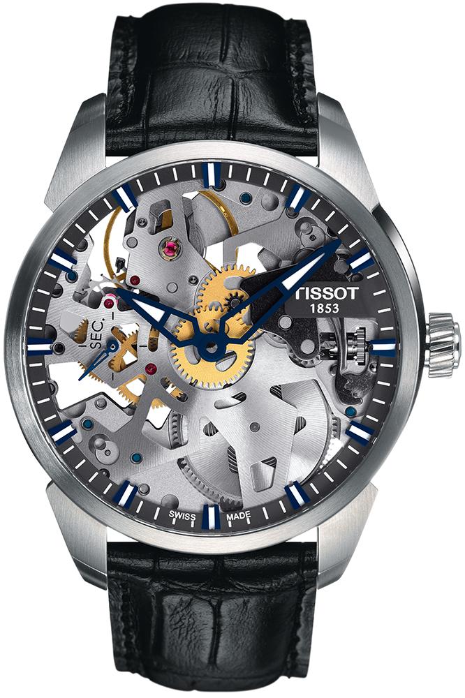 Luksusowy, męski zegarek Tissot T070.405.16.411.00 T-COMPLICATION SQUELETTE MECHANICAL na skórzanym, czarnym pasku z motywem skóry krokodyla. Analogowa tarcza zegarka jest w style skeleton pokazująca cały mechanizm jak i prace zegarka. Indeksy zegarka są w białym kolorze, a wskazówki w granatowym.
