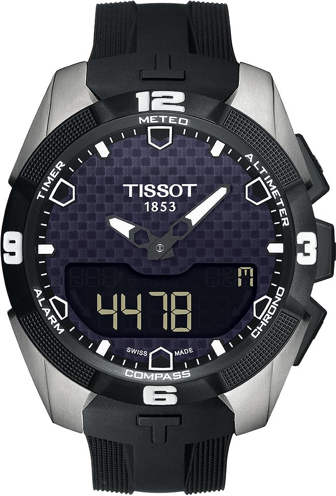 Sportowy, męski zegarek Tissot T091.420.47.051.00 T-TOUCH EXPERT SOLAR na pasku wykonanym z tworzywa sztucznego w czarnym kolorze oraz okrągłej kopercie wykonanej ze stali w srebrnym kolorze. Analogowo-cyfrowa tarcza jest w czarnym kolorze ze wzorem szachownicy. Wskazówki jak i indeksy są czarno białe.