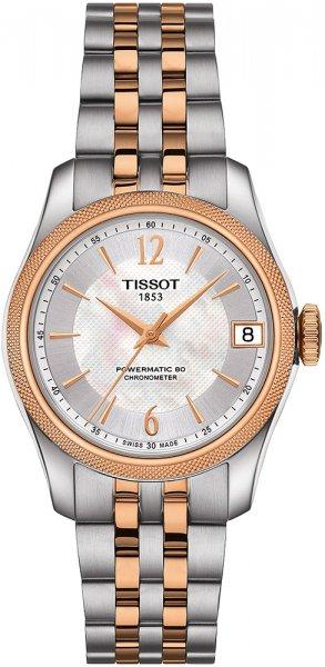 Klasyczny, damski zegarek Tissot Ballade Powermatic 80 na klasycznej bransolecie ze stali w srebrnym kolorze z paskami w kolorze różowego złota. Bezel zegarka jest w kolorze różowego złota a tarcza w srebrnym, mieniąca różnymi się odcieniami.