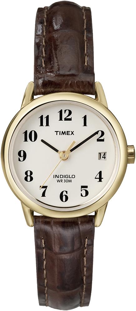 Modny, damski zegarek Timex Easy Reader na skórzanym pasku z stalową koperta pokryta PVD w kolorze złota. Analogowa tarcza zegarka jest w beżowym kolorze z czarnymi, czytelnymi indeksami oraz wskazówkami. Zegarek posiada również mały datownik pokazujący dzień tygodnia.