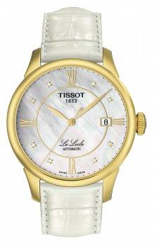 Klasyczny, damski zegarek Tissot T41.5.453.86 LE LOCLE AUTOMATIQUE Gent na skórzanym białym pasku z okrągłą, stalową kopertą pokryta powłoką PVD w złotym kolorze. Analogowa tarcza zegarka jest zrobiona z masy perłowej oraz ozdobiona datownikiem na godzinie trzeciej. Tarcze zdobią również diamenty i indeksy jak i wskazówki w złotym kolorze.