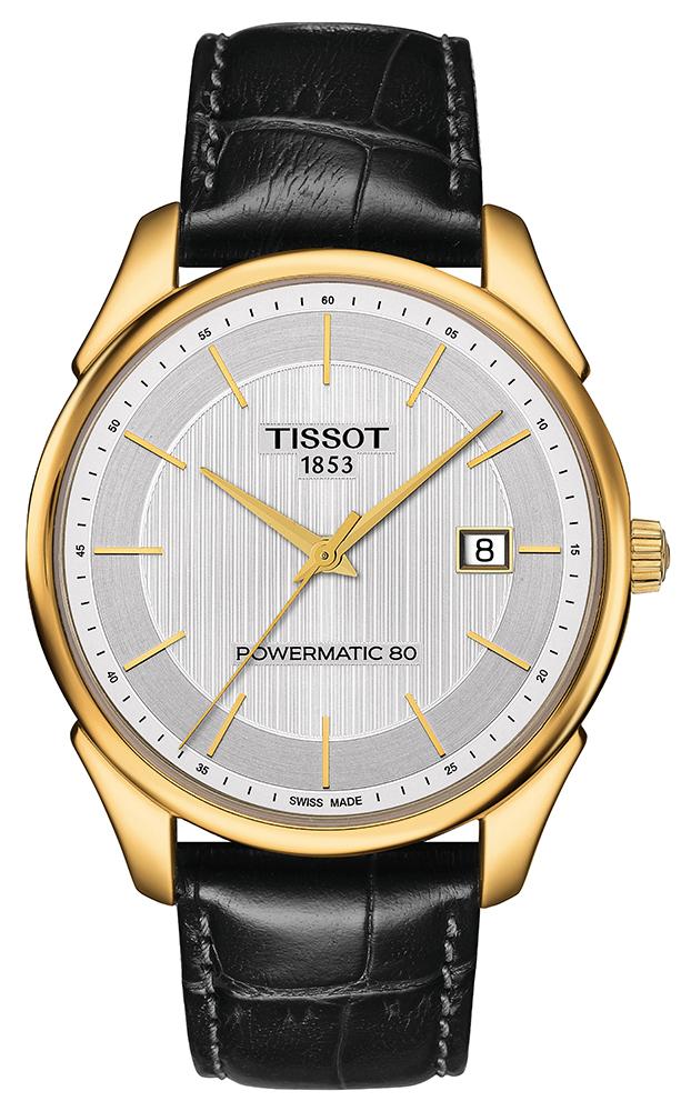 Luksusowy, męski zegarek Tissot T920.407.16.031.00 VINTAGE POWERMATIC 80 18K GOLD na skórzanym pasku w czarnym kolorze oraz kopercie wykonanej ze złota w złotym kolorze. Analogowa tarcza jest w srebrnym kolorze z datownikiem na godzinie trzeciej. Wskazówki jak i indeksy sa w złotym kolorze.