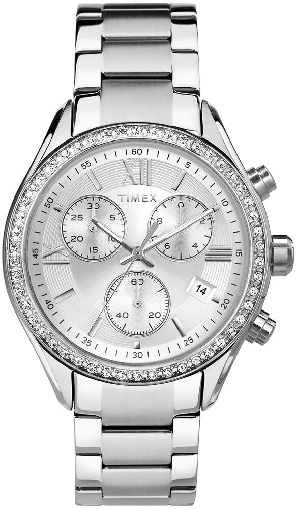 Elegancki, damski zegarek Timex TW2P66800 Miami z koperta ozdobiona diamencikami Swarovskiego i bransoletą w srebrnym kolorze, wykonanych ze stali. Tarcza zegarka jest srebrna z trzema subtarczami oraz datownikiem na godzinie czwartej. Wskazówki jak i indeksy są w srebrnym kolorze.