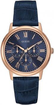 Stylowy, męski zegarek Guess W0496G4 na skórzanym pasku w niebieskim kolorze ze stalową kopertą pokrytą powłoka PVD w kolorze złotego różu. Analogowa tarcza zegarka jest w kolorze niebieskim z niebieskimi subtarczami ozdobionymi złotym różem. Indeksy jak i wskazówki są w kolorze różowego złota