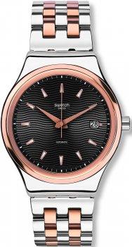 Elegancki, męski zegarek Swatch YIS405G SISTEM TUX na bransolecie z koperta wykonanych ze stali w kolorze różowego złota i srebra. Giloszowana tarcza zegarka jest w czarnym kolorze z datownikiem na godzinie trzeciej. Wskazówki jak i indeksy są również w kolorze różowego złota.