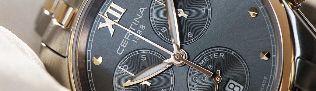 Zegarek Certina z czarną tarczą przedstawiającą komplikacje.