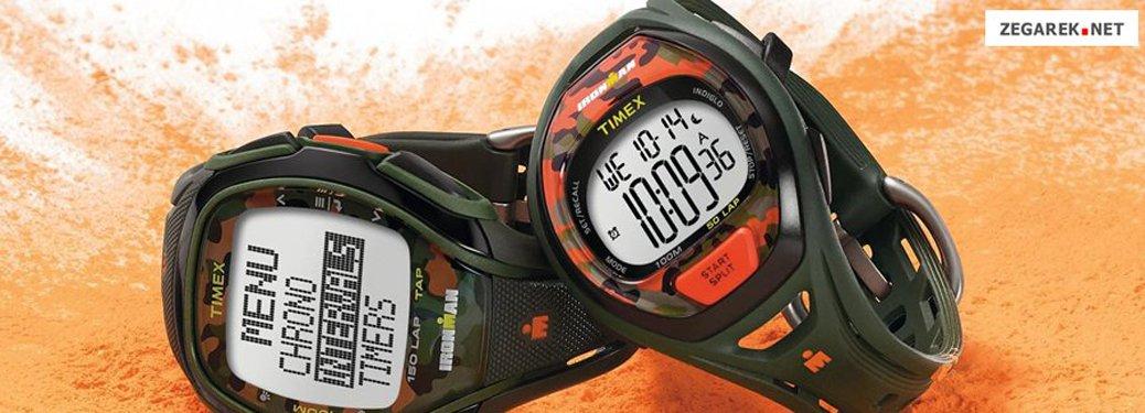 Zegarki Timex Ironman w kolorach moro z orzeźwiającymi pomarańczowymi akcentami.