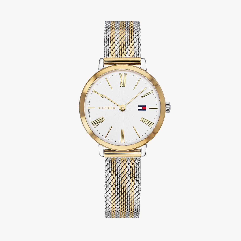 Klasyczny, damski zegarek Tommy Hilfiger 1782055 Zendaya na srebrno-złotej bransolecie typu mesh. Okrągła stalowa koperta jest w srebrnym jak i złotym kolorze. Tarcza zegarka jest biała z złotymi indeksami.