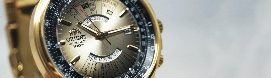 Zegarek Orient FEU07004UX w złotym kolorze z wiecznym kalendarzem.