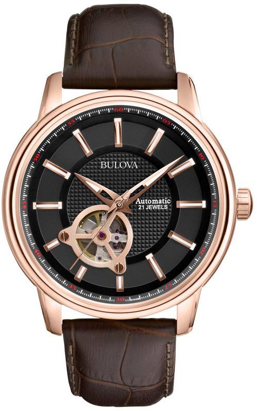 Klasyczny, męski zegarek Bulova 97A109 Automatic na skórzanym, brązowym pasku z koperta wykonaną ze stali oraz pokryta powłoka PVD w kolorze różowego złota. Tarcza zegarka jest czarna z open heart. Wskazówki jak i indeksy zegarka są w kolorze różowego złota.