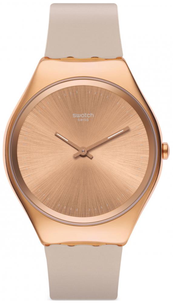 Zegarek Swatch SYXG101 w kolorze różowego złota na pasku wykonanym z tworzywa sztucznego.
